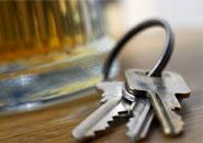 designated driver's keys next to alcohol