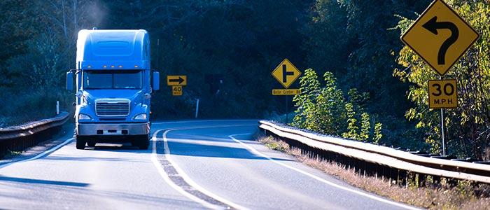 Truck driving around bend