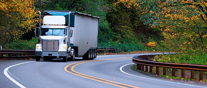 Tractor Trailer Driving Around Winding Road
