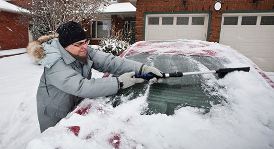 cleaning snow off car