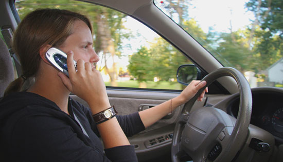 Teens use cell phones while driving despite risks