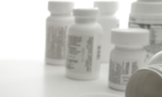 painkiller white pill bottles