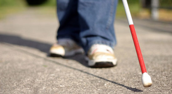 blind person with walking stick