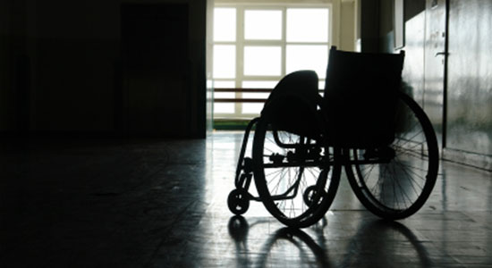 spinal cord injury victim in wheelchair