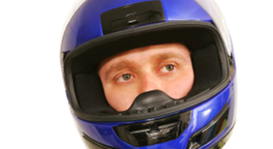motorcyclist wearing helmet