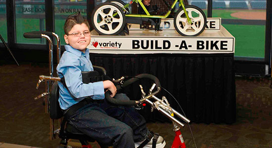 child with special needs on adaptive bike
