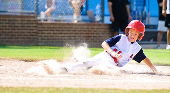 boy sliding in baseball