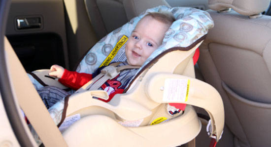 child safely buckled in a car seat