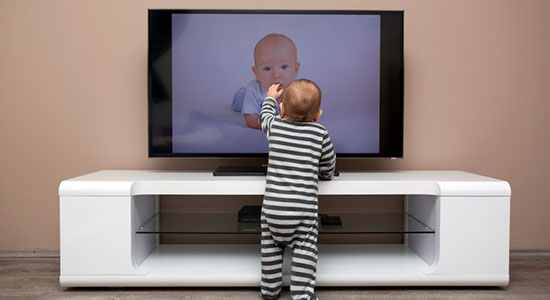child tipping over TV