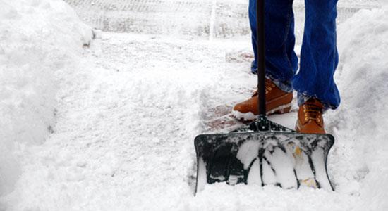 shoveling sidewalk snow and ice